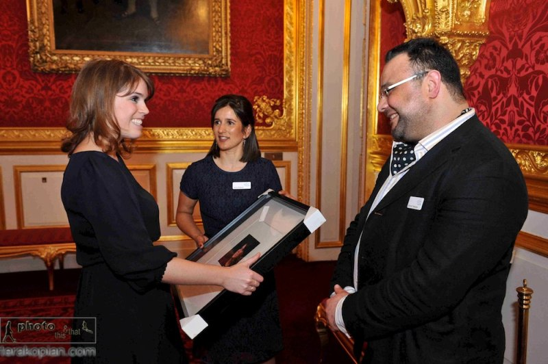 The RNOH launch their funding appeal at St James's Palace in London. Photographer Edmond Terakopian and Rosie Stolarski (head of fundraising), present HRH Princess Eugenie with a portrait of herself (taken by Edmond Terakopian). April 26, 2012. Photo: Theodore Wood / www.theodorewood.com