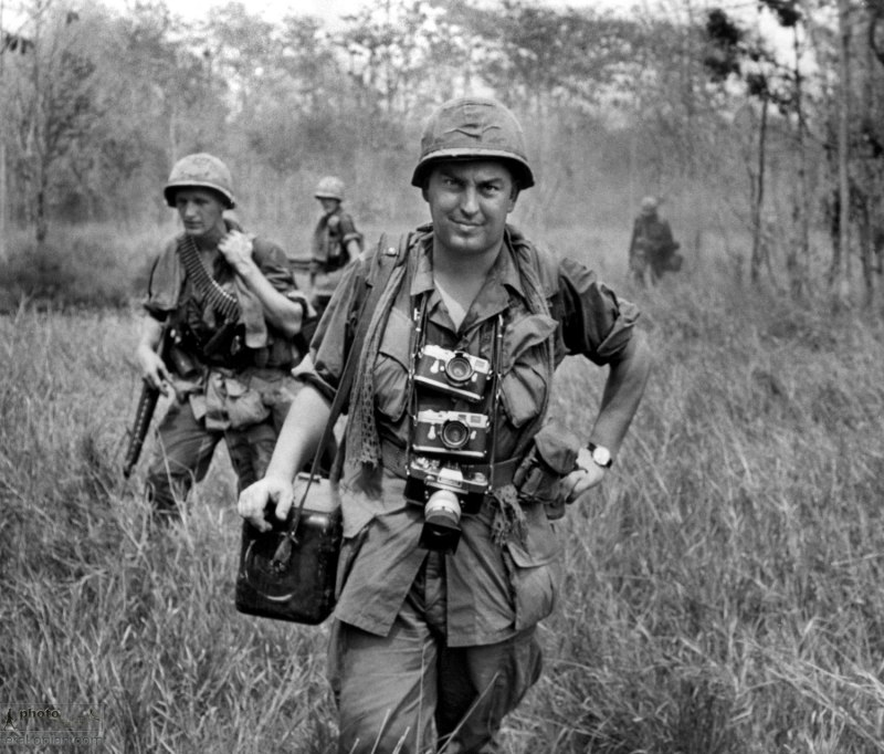 Vietnam 1967 -- AP photographer Horst Faas, with his Leica cameras around his neck, accompanies U.S. troops in War Zone C. (AP Photo)