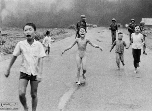 In this June 8, 1972 file photo, crying children, including 9-year-old Kim Phuc, center, run down Route 1 near Trang Bang, Vietnam after an aerial napalm attack on suspected Viet Cong hiding places as South Vietnamese forces from the 25th Division walk behind them. A South Vietnamese plane accidentally dropped its flaming napalm on South Vietnamese troops and civilians. From left, the children are Phan Thanh Tam, younger brother of Kim Phuc, who lost an eye, Phan Thanh Phouc, youngest brother of Kim Phuc, Kim Phuc, and Kim's cousins Ho Van Bon, and Ho Thi Ting. AP Photo/Nick Ut