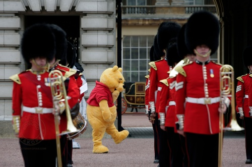 Poo And The Band. Winnie The Poo lines up with the band in the forecourt of Buckingham Palace for the children's party. June 25, 2006. Photo: ©Edmond Terakopian