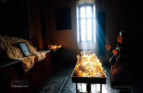 10 years on from the Armenian earthquake. A woman prays for the souls of the dead in a Gyumri church. 6 December 1998, Gyumri, Armenia. Photo: ©Edmond Terakopian