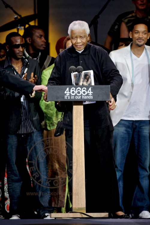 Nelson Mandela, left, speaking as Will Smith, second from left looks on at the 46664 charity concert in honour of Mandela's upcoming 90th birthday in London. The 46664 Concert, Hyde Park. June 26, 2008. Photo: ©Edmond Terakopian