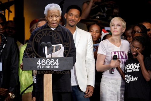 Nelson Mandela, left, speaking as Will Smith, second from left and Annie Lennox, right, look on at the 46664 charity concert in honour of Mandela's upcoming 90th birthday in London. The 46664 Concert, Hyde Park. June 26, 2008. Photo: ©Edmond Terakopian
