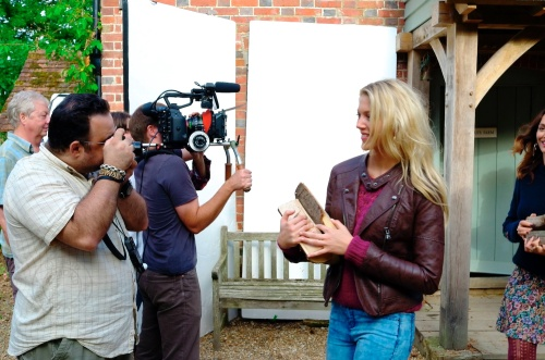Edmond Terakopian photographing Sophie Harries for the New Look video shoot of their Autumn / Winter 2013 collection. Advertising film by Cherry Duck. Walnuts Farm, Old Heathfield, East Sussex, UK. August 22, 2013. Photo: ©James Vellacott