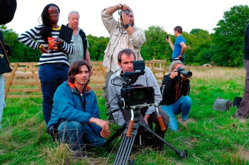 Edmond Terakopian photographing the New Look video shoot of their Autumn / Winter 2013 collection. Advertising film by Cherry Duck. Walnuts Farm, Old Heathfield, East Sussex, UK. August 22, 2013. Photo: ©James Vellacott