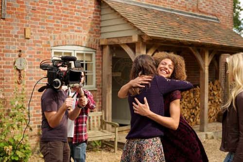Models Lizzie Bowden (navy jumper) and Leanne Pollock. New Look behind the scenes shoot of their Autumn / Winter 2013 collection advertising film by Cherry Duck. Walnuts Farm, Old Heathfield, East Sussex, UK. August 22, 2013. Photo: ©Edmond Terakopian