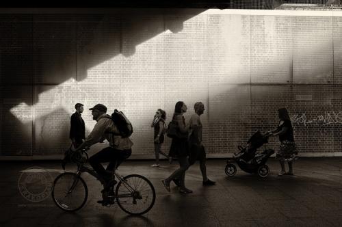 London's South Bank.  Pedestrians walk past a bridge.   July 15, 2013. Photo: ©Edmond Terakopian / 2013