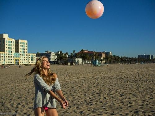 Andrea Feczko (American TV Presenter and digital content creator. www.andreafeczko.com), plays volleyball on Venice Beach. LA, USA. January 14, 2014. Photo: Edmond Terakopian