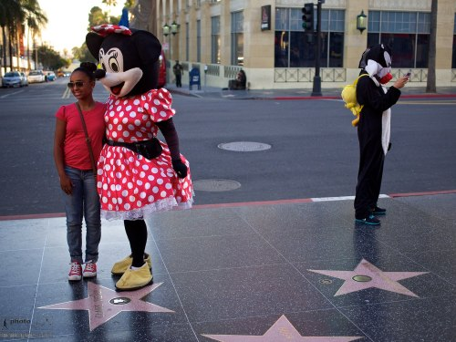 Cartoon characters interact with the tourists. Walk of fame, Hollywood Boulevard, Hollywood, California. January 16, 2014. Photo: Edmond Terakopian