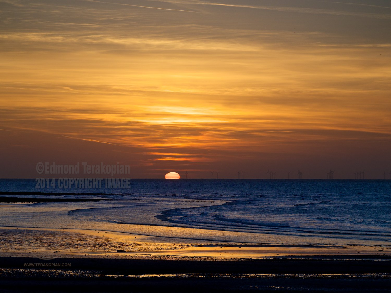 The sun sets over Margate Sands. Kent. April 15, 2014. Photo: ©Edmond Terakopian