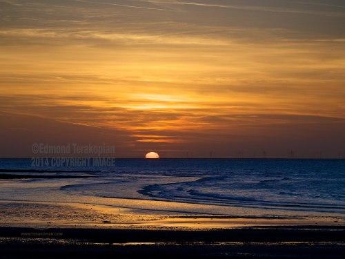 The sun sets over Margate Sands. Kent. April 15, 2014. Photo: ©Edmond Terakopian