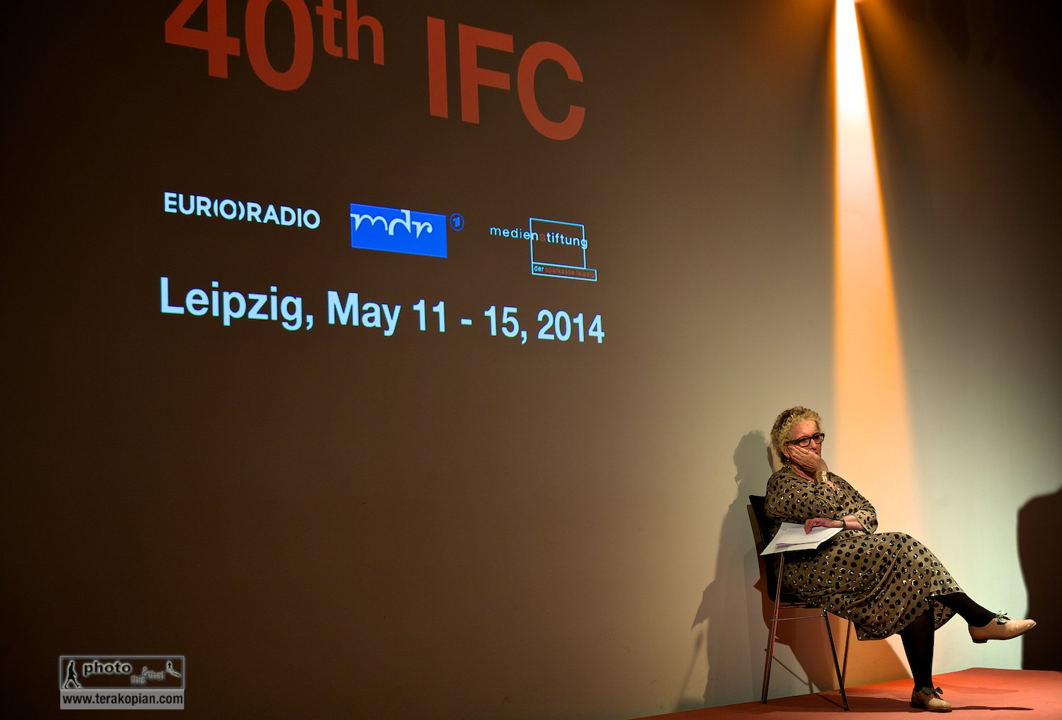 Official opening of the IFC (International Features Conference). Lorelei Harris (RTE) listens to the opening speech from the stage. Media Campus (Medienstifftung der Sparkasse Leipzig), Poetenweg, Leipzig, Germany. May 11, 2014. Photo: Edmond Terakopian