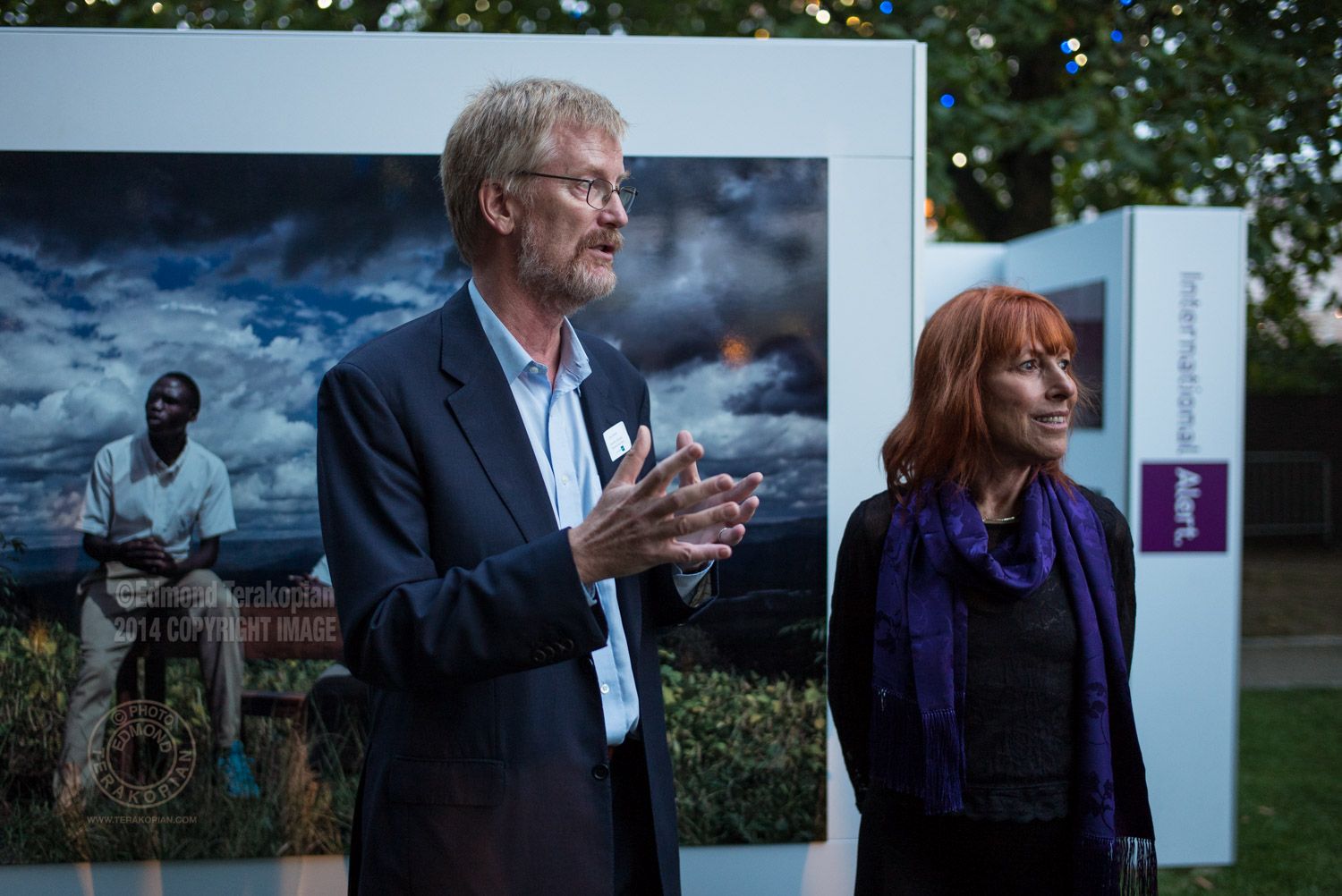Dan Smith, Secretary General of International Alert  and Carol Allen Storey. The Amahoro Generation by Carol Allen Storey for International Alert. The outdoor exhibition is at the Bernie Spain Gardens, Riverside Walksway (by Oxo Tower Wharf), South Bank, London. September 18, 2014. Photo: Edmond Terakopian
