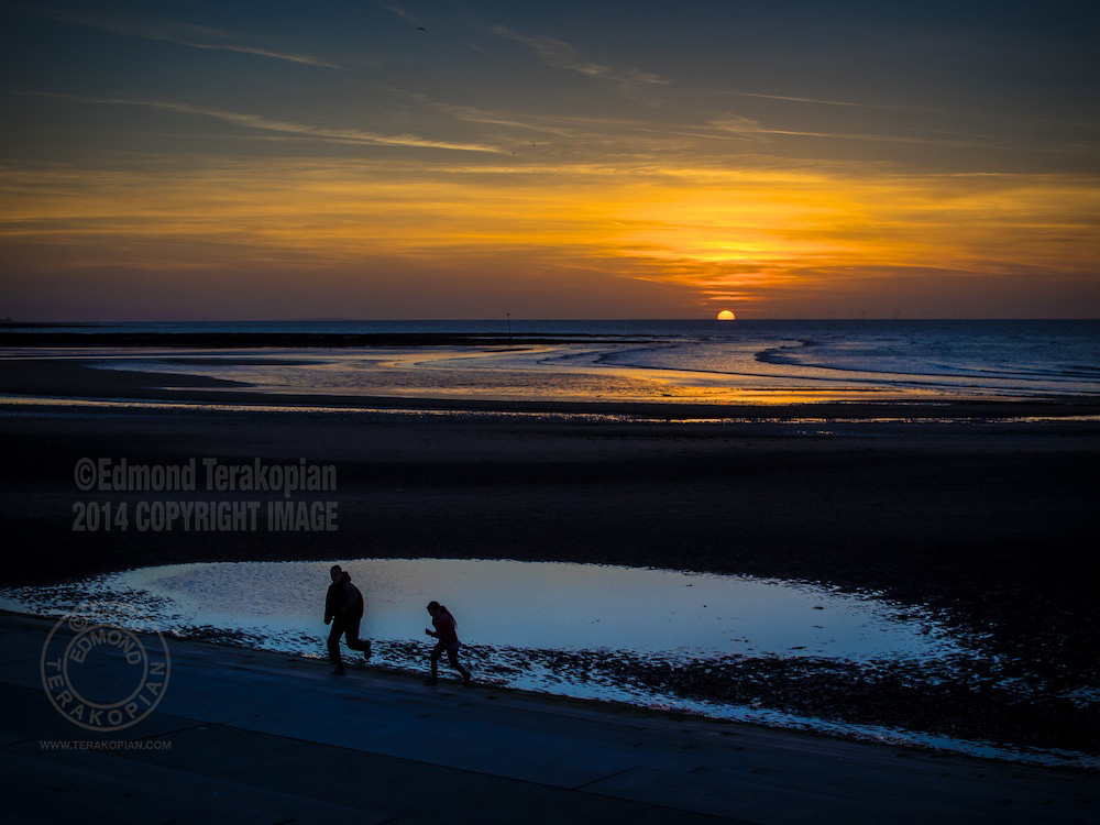 Sunset run,  This image was shot on an Olympus OM-D E-M1 camera and Olympus M.Zuiko 25mm f1.8 lens. Margate Sands, Kent. April 15, 2014. Photo: ©Edmond Terakopian