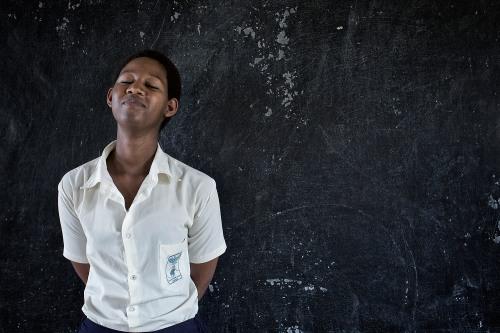 Portrait of Jeanne Unutomi, student at the STAR Secondary School, 20 years old, defining Amahoro, Peace. Masaka, Rwanda, June 6, 2014. Photo: Carol Allen-Storey.
