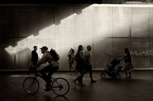 London's South Bank.  Pedestrians walk past a bridge.   July 15, 2013. Photo: ©Edmond Terakopian / 2013