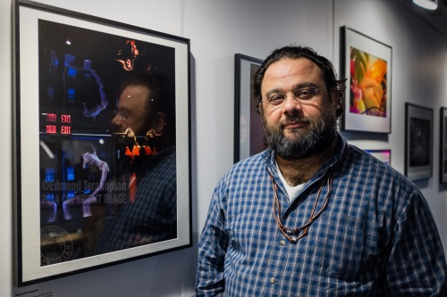 2014 AOP Photographers Awards. Photographer Edmond Terakopian by his portrait of Andrea Feczko which was a finalist in the Open Award. Islington Business Design Centre, London. December 11, 2014. Photo: Nathan Wake