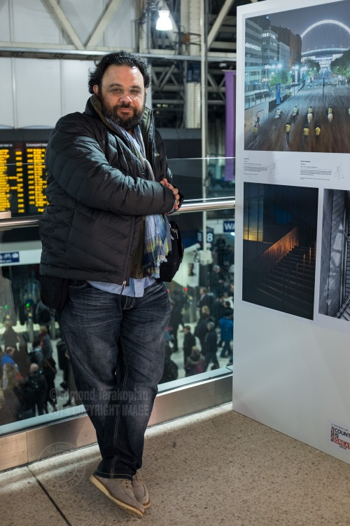 The Landscape Photographer of the Year exhibition at London's Waterloo Station, Mezzanine level. Edmond Terakopian by his image from Margate which won a Commendation. December 01, 2014. Photo: Paul Robertson