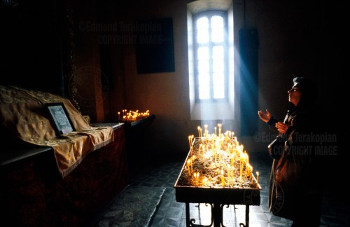 A woman prays for the souls of those who died in a Gyumri church. 10 years on from the Armenian earthquake. 6 December 1998, Gyumri, Armenia. Photo: Edmond Terakopian