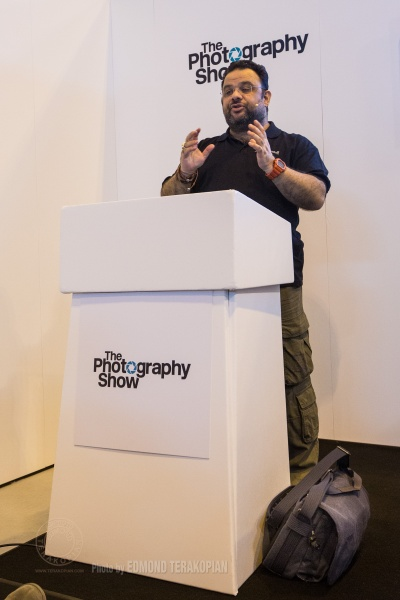 """Essentials In Documentary Film Making"" talk by Edmond Terakopian at the Filmmaker Theatre on behalf of Snapper Stuff. My laptop bag, a blue Think Tank Photo Retrospective 13L can be seen by the podium. The Photography Show, NEC, Birmingham. March 23, 2015. Photo: Freia Turland"