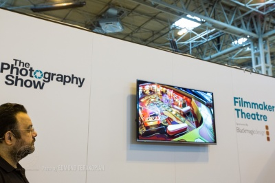 """Essentials In Documentary Film Making"" talk by Edmond Terakopian at the Filmmaker Theatre on behalf of Snapper Stuff. Showing ""1 Sixpence 1 Play"", shot on the Olympus OM-D E-M1. The Photography Show, NEC, Birmingham. March 23, 2015. Photo: Freia Turland"