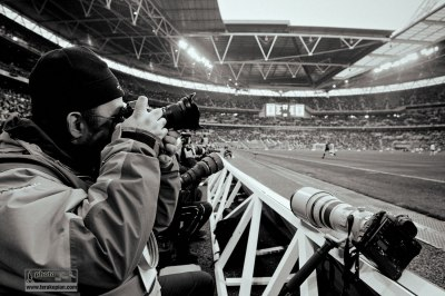 Edmond Terakopian at the new Wembley Stadium, covering the first football game after it's opening. Photo: Stuart Emmerson