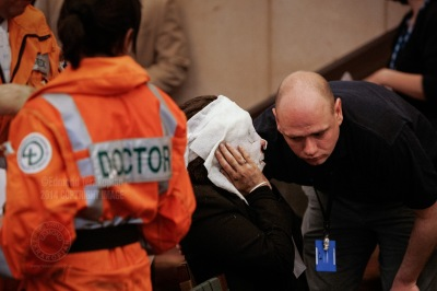 An injured Davinia Turrell (now Davinia Douglass) from the Edgware Road Station Underground suicide bomb attack get medical attention in the triage area set up at the Hilton London Metropole Hotel in Edgware Road. The bomber blew himself up on a train at the station, killing seven passengers - one of four coordinated attacks on London's public transport system during the morning rush hour. The bombs exploded within 50 seconds of each other on London Underground trains, and the fourth bomb occurred on a bus less than an hour later. The explosions resulted in some 56 deaths (including those of the four bombers) and 700 injuries. Surveillance video footage showed that the four men had been working together. Intelligence services have claimed links between the bombers and al-Qaeda. Edgware Road underground station, London, United Kingdom. July 07, 2005. Photo: Edmond Terakopian