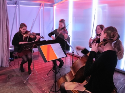 A string quartet from the Royal College of Music performs at the opening and private view of