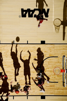Ron Baker (31) shoots over Nick Zeisloft (2) as Hanner Mosquera-Perea (12) and Rashard Kelly (0) battle for position under basket at the NCAA 2015 Mens Basketball Tournament game with Wichita State vs. Indiana at the CenturyLink Center in Omaha, Nebraska, USA on March 20th of 2015. Greg Nelson executed this photograph without posing any of the subjects.