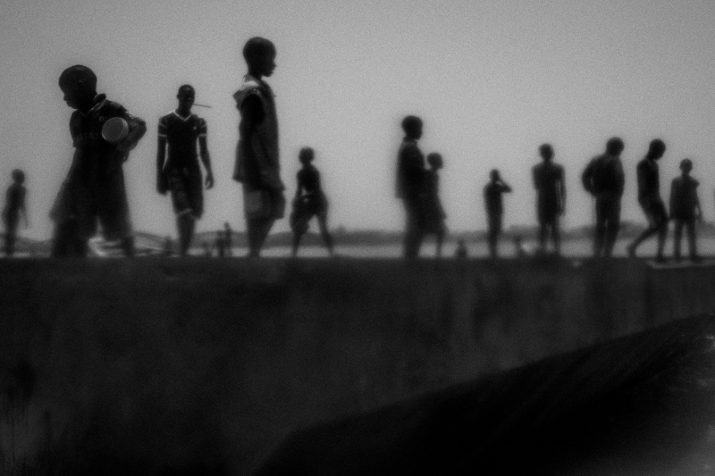 Runaway talibes stand on the bank of Senegal river, in Saint Louis city, north of Senegal, May 20, 2015. Saint Louis is known as Talibe city. A city with small proportions compared to Dakar but with a large number of Talibes. Due to that many of them choose the streets instead of Daaras.