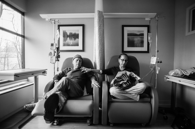 """Howie calls these """"his and hers"""" chairs. He sits beside Laurel, his wife of thirty-four years, as they get their weekly chemotherapy treatments, side by side at Oncologist Dr. Barry Boyd's office. Greenwich, Connecticut. January, 2013."""