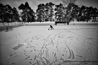 Vetluga's Hockey. Evgeny Solovyov, head coach of HC Vetluga preparing the stadium for the match. Players of an amateur hockey team in provincial Russia before, during and after a game in the regional championship in Vetluga, Nizhny Novgorod Oblast, Russia. Photo: Vladimir Pesnya