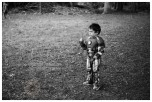 Elvis dressed as Iron Man shows his strength as he breaks a twig at his older brother's birthday party. Roxbourne Park, Ruislip. April 03, 2016. Photo: Edmond Terakopian